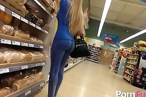 Nice blonde is being filmed in the store because she has a juicy ass